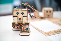 Close-up of a robot made of plywood