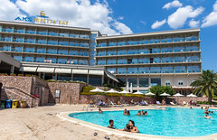 Holiday Guests in the Pool of the Aks Hinitsa Bay beach hotel in the Peloponnes, Greece