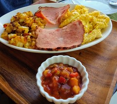 Canadian Bacon, eggs and home fries, with a tasty salsa - Breakfast at the Poipu Bed & Breakfast Inn, Koloa
