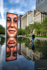 Image by NettyA (7272097@N08) and image name Crown Fountain photo  about Early morning (about 8am when it first starts up) at Crown Fountain in Millennium Park, Chicago. The fountain shows a continuing array of local people's faces. After a few minutes of each face, water comes out of their mouth.