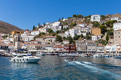 Luxurious yachts in the harbour off Miaouli of saronic island Hydra, Greece