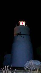 Strahlender Leuchtturm von Spetses bei Nacht