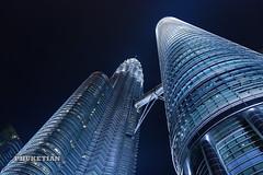 Skyscrapers of Kuala Lumpur, Malaysia. Petronas Twin Towers at night XOKA7800bs