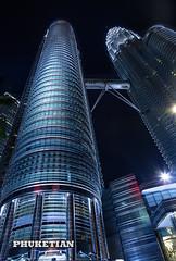 Skyscrapers of Kuala Lumpur, Malaysia. Petronas Twin Towers at night    XOKA7802b2s