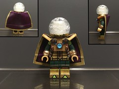 "Image by EA_Customs (149480961@N04) and image name Custom Lego Spider-Man Characters: Mysterio photo  about This one was inspired by his look in FFH and just my own design.  His dome is a cut Lego piece . The inside is coated with super glue and it's over a GITD head. And the rim is sculpted.  The cape is e-tape.  The armour is from a Chima set, and painted to have an ""M"" onthe chest.  Arm gauntlets are s"