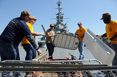 Chief petty officers work on ships in Battleship Cove.