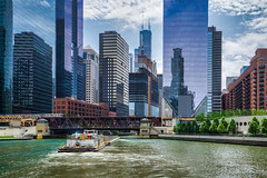 Image by NettyA (7272097@N08) and image name Barge on Chicago River photo  about We were lucky to see a working barge on the Chicago River during our architecture boat cruise. Our guide was very excited to see it. Also, check out the amazing building on the rhs of the bridge.  I process my photos with Skylum's Luminar and find it easy to use with great results. Here is a link if