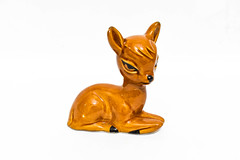 Small fawn figurine on white background
