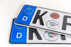 Two German license plates of the city Cologne - North Rhine-Westphalia, with white background