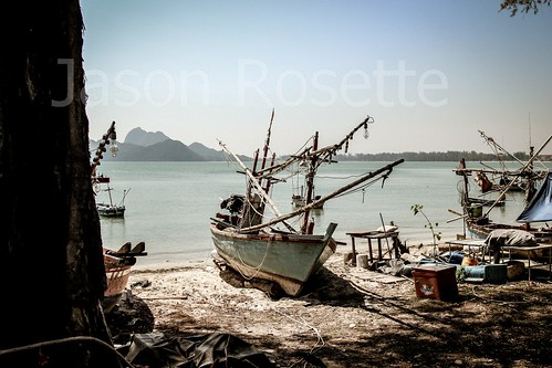 Old Fishing Boat on Shore of Bay  in Thailand