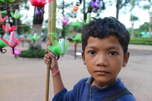 Portrait of boy selling toy birds, Siem Reap, Cambodia