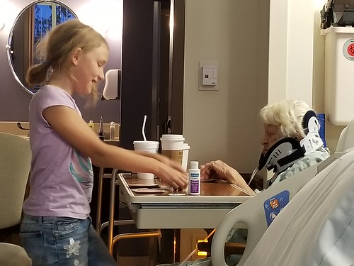 The girls playing cards with Grandma Pearl at Aurora Summit - 081619