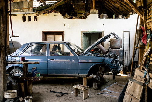 Damaged old Mercedes in the backyard of a farmhouse. Prepared for restoration