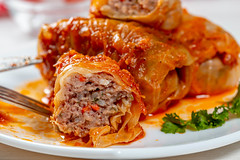 Close-up of cut stuffed cabbage with minced meat and rice inside
