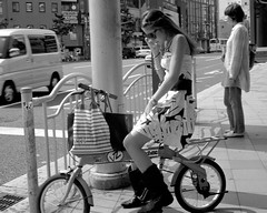 Girl on bike with cellphone, June 2010
