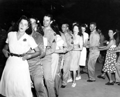 Servicemen in a conga line with women at the Gainesville Recreation Department's Service Center