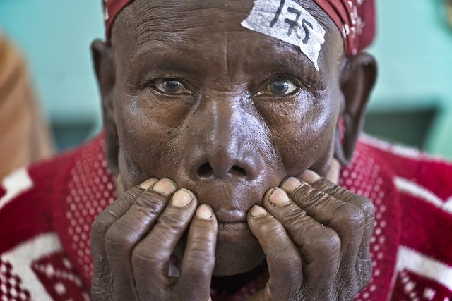 Moments of uncertainty, before her first visual exam. Free Cataract Surgery Camp at Nakuru County Referal Hospital. Kenia.