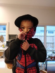 Image by avlxyz (avlxyz) and image name Liam the ninja in a Spiderman hoodie photo