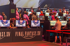 Young games fair visitors play the multiplayer online role-playing game Final Fantasy XIV Shadowbringers