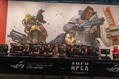 Fair visitors behind monitors at the game station of the free-to-play battle royale shooter Apex Legends by EA at Gamescom in Cologne