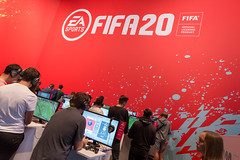 Young gamers play FIFA 20 from EA Sports at the German games fair Gamescom