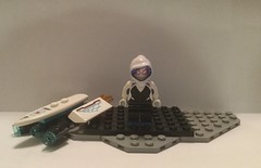 Image by Wilson, Wilson, & Wilkins (161224061@N04) and image name Lego Custom: Spider-Gwen/Ghost Spider (Updated)(Marvel) photo  about So I basically combined my custom with the official, and then I made some more well deserved modifications, I added that board from the set in the display too because I thought it looked cool.