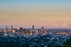 Image by NettyA (7272097@N08) and image name Brisbane sunset photo  about A recent sunset over Brisbane from Mt Coot-tha Lookout. On our walk back down to our car, we were very excited to see a koala in, I think, a Queensland blue gum tree.  I process my photos with Skylum's Luminar and find it easy to use with great results. Here is a link if anyone is interested in tryi