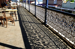 Image by Diepflingerbahn (154254464@N08) and image name A place in the sun.... photo  about Shadows cast by balcony ironwork,  Old Vic Inn, Canowindra NSW.