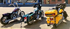 Image by peggyhr (artsylens) and image name Purple, green & yellow Harley-Davidson bikes (+3) photo  about Cool to see the riders arrive and park their bikes on Main Street, Fort Macleod, a southern Alberta community which has been transformed into a picturesque mid-western American town in Oklahoma as the cast and crew of Ghostbusters 2020 film the latest instalment of the franchise.  While the majority