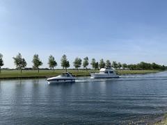 Image by Omroep Zeeland (63018044@N02) and image name Wilhelminadorp photo  about Door Erica van Leeuwen-de Bruijn, Kloetinge Heerlijk weer om het water op te gaan.