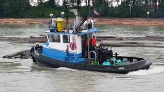 River Star working with a log boom