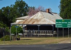 Gayndah Queensland. Established 1849.  An old cottage and flowering tree near the town museum.