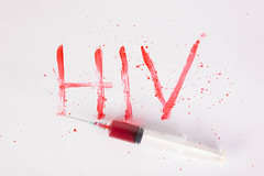 Bloody word HIV with injection needle
