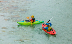Kayakers on the famous turquoise Soca river, Bovec, Slovenia