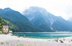 Lake Predil with turquoise water and mountains in background near Tarvisio in European Alps