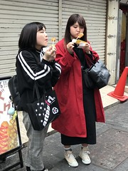These two girls finally decided to take away to eat on the street