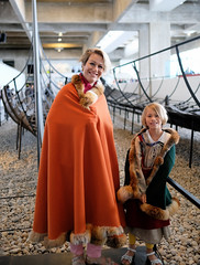 Two vikings in front of their ships