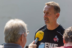 German radio station interviews soccer coach Achim Beierlorzer after the training session of his cologne soccer team