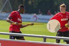 Soccer player Kingsley Ehizibue and goalkeeper Julian Krahl having fun after football training on the pitch in Cologne