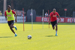 Nikolas Terkelsen Nartey - defensive midfield - and football player Kingsley Ehizibue outside on the field at 1. FC Köln training center