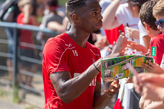 Footballer Kingsley Ehizibue gives autographs and talks to young football fans and children after his practice session