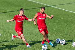 Defender Mitchell Weiser and football colleague Karim Bellarabi fight for the ball during training session in Germany