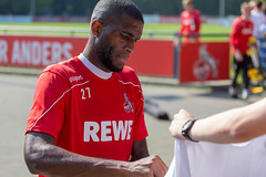 Middle striker Anthony Modeste signs autograph on fan shirts after soccer training in Cologne