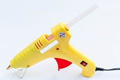 Hot glue gun on white background