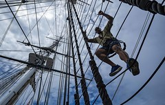 Chief petty officer selects, Sailors who have been selected for the paygrade of E-7, participate in a mast climbing evolution during Chief Heritage week aboard the oldest commissioned warship afloat in the world, USS Constitution.