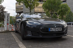 Front view of a black Tesla Model S 90D during charging process at a German TankE charging station of RheinEnergie