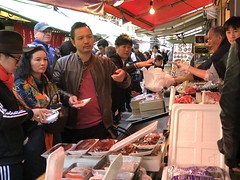More Chinese tourists crowd one of the many sushi places at Tsukiji
