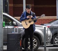 Guitarist at Tram Stop