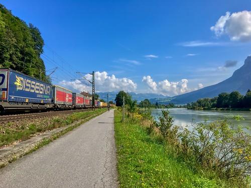 Freight train passing the river Inn between Kufstein, Tyrol, Austria and Kiefersfelden, Bavaria, Germany