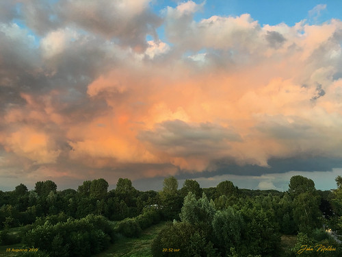 The clouds are colored in the orange-yellow-red
